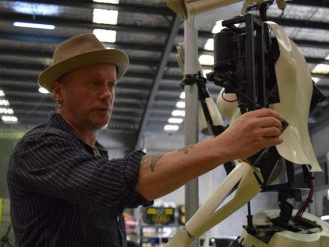 Artist Giles Walker works on his Robotic creation. Picture: Supplied
