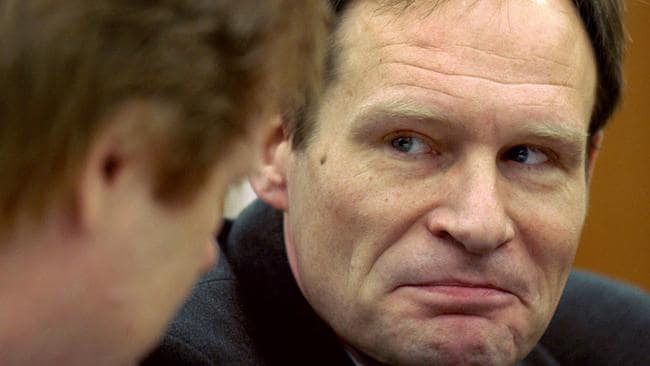 Armin Meiwes talks to his lawyer Harald Ermel (L) at regional court in Kassel, in December 2003.