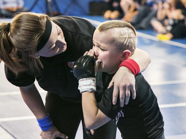 "Mason ""The Beast"" Bramlette, 7, cries after receiving a punch during 2013 California State Pankration Championships Youth Division. Photo: AUSTRAL/Sebastian Montalvo/Polaris"