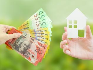 Client giving Australian money to property agent for buying house