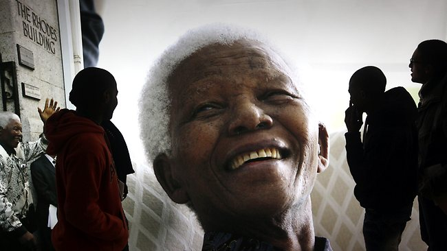 Giant photographs of former president Nelson Mandela are displayed at the Nelson Mandela Legacy Exhibition at the Civic Centre in Cape Town, South Africa.