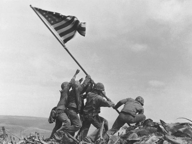 The 1945 flag raising at Iwo Jima by the AP's Joe Rosenthal is included in Time magazine's most influential images of all time. Picture: AP Photo/Joe Rosenthal, File
