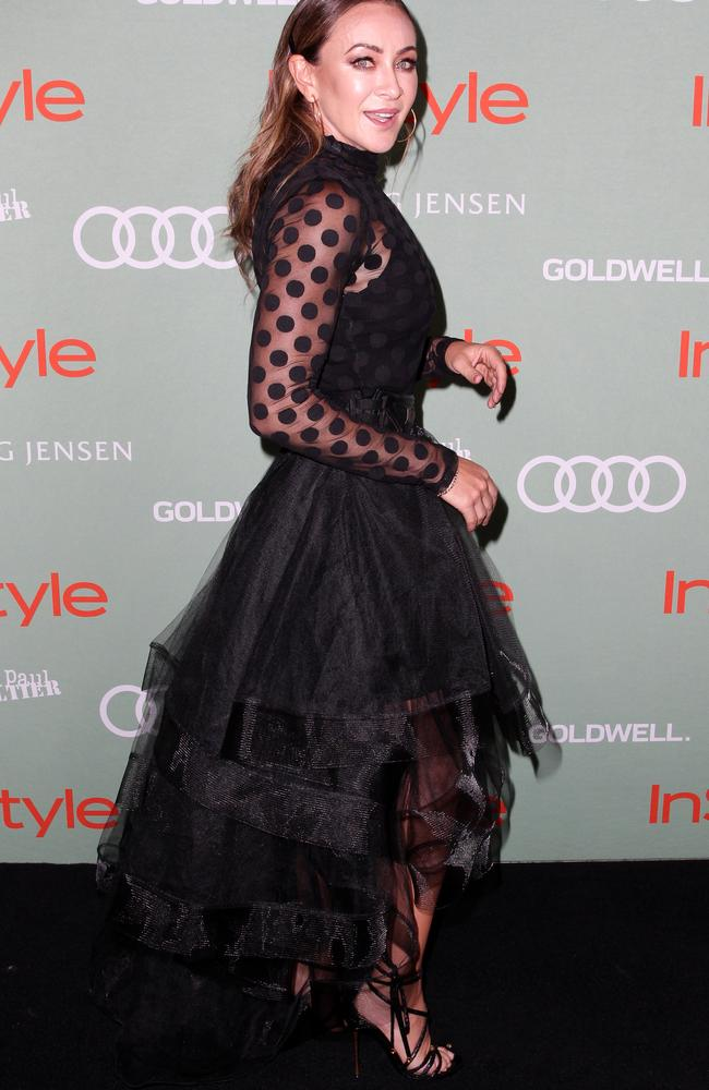 Fitness guru Michelle Bridges also opted for a sheer top and flounced skirt. Picture: Christian Gilles