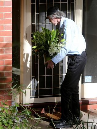 A taxi driver delivers flowers to Bob Such's front door after news broke that he was taking a two-month leave because of illness. Picture: Simon Cross