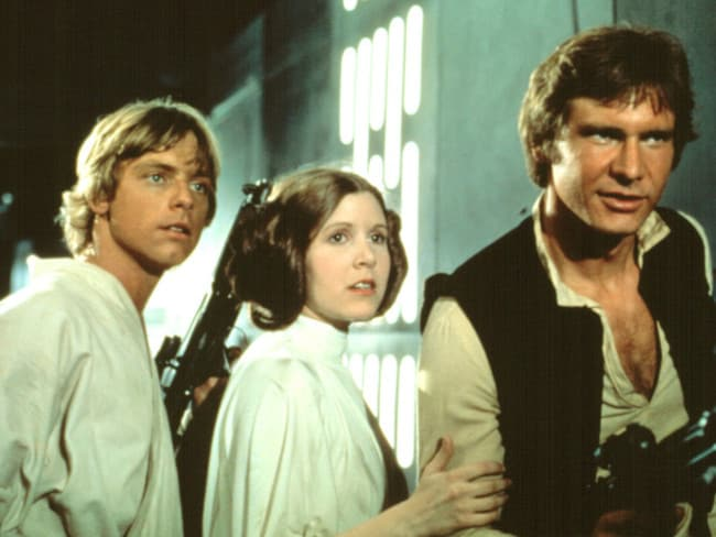 The original Star Wars trio Mark Hamill, Carrie Fisher and Harrison Ford in 1977.