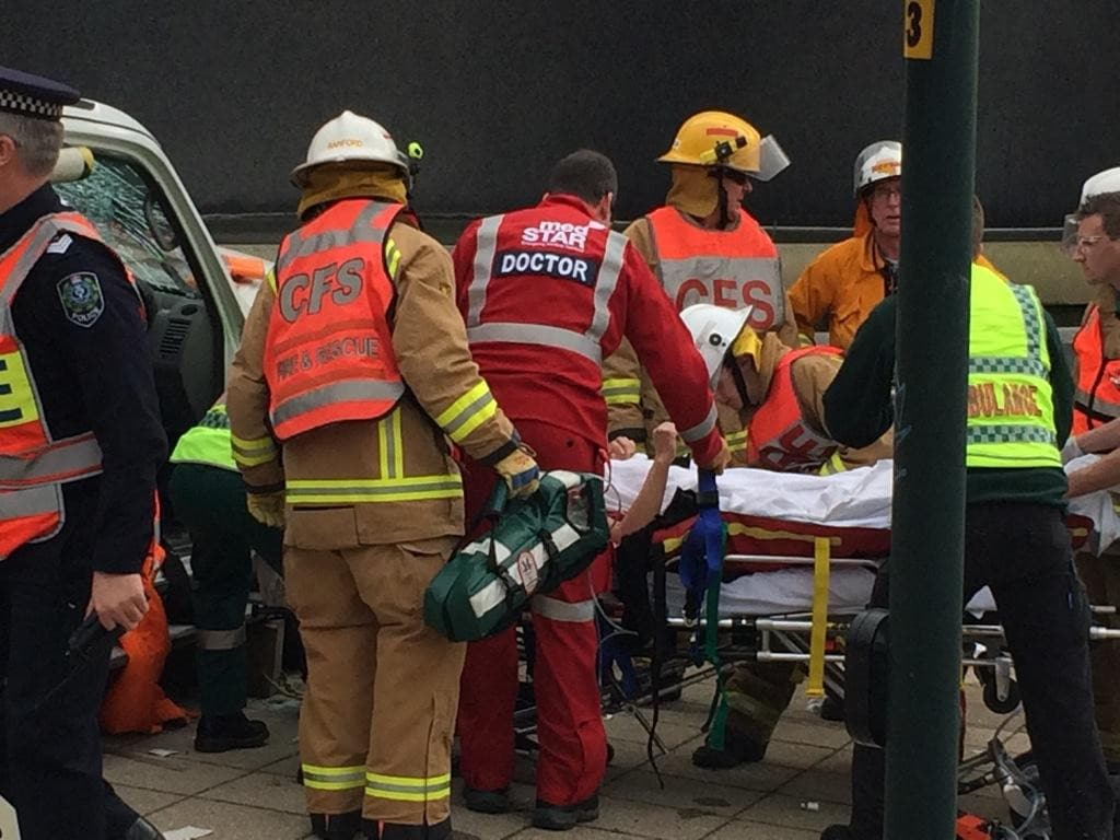 Paramedics with one of the crash victims. Picture: Sam Kelton