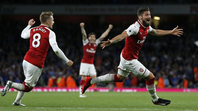 Arsenal's French striker Olivier Giroud (C) celebrates scoring Arsenal's fourth goal during the English Premier League football match between Arsenal and Leicester City at the Emirates Stadium in London on August 11, 2017. / AFP PHOTO / Ian KINGTON / RESTRICTED TO EDITORIAL USE. No use with unauthorized audio, video, data, fixture lists, club/league logos or 'live' services. Online in-match use limited to 75 images, no video emulation. No use in betting, games or single club/league/player publications. /