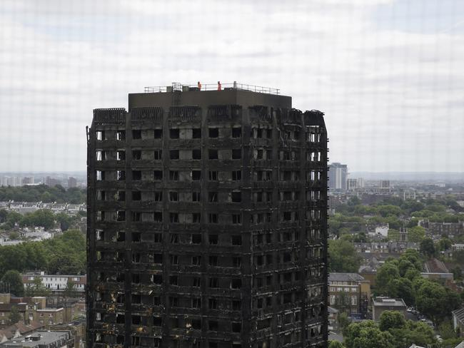 Emergency workers have reached the top of the Grenfell Tower inferno as work continues to identify the victims inside. Picture: AP Photo/Matt Dunham, File