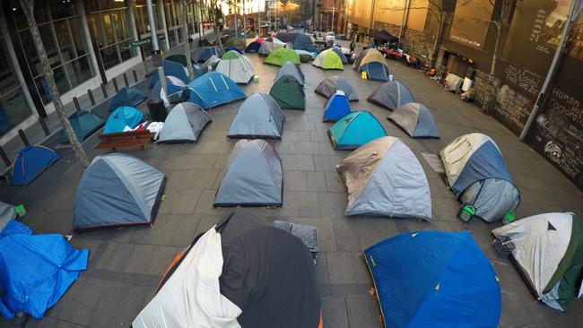 The tent city popped up outside the Reserve Bank in Martin Place. Picture Toby & Martin Place tent city: Family and Community Services Minister Pru ...