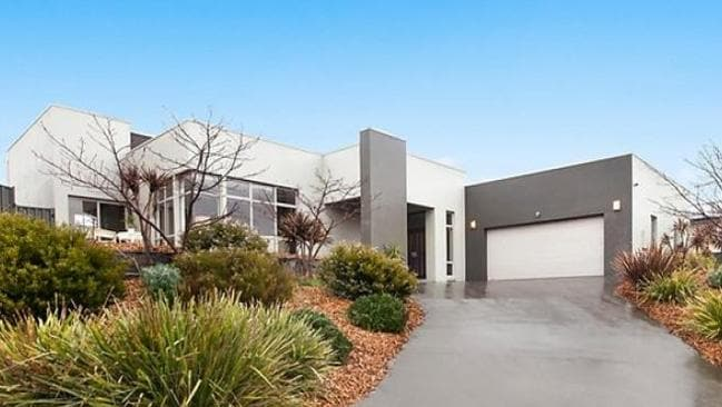 A four-bedroom home at 23 Myrtle Close, Jerrabomberra has an asking price of $975,000. Picture: realestate.com.au