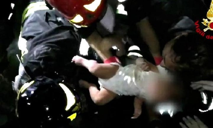 Baby found alive and rescued from earthquake rubble in Italy