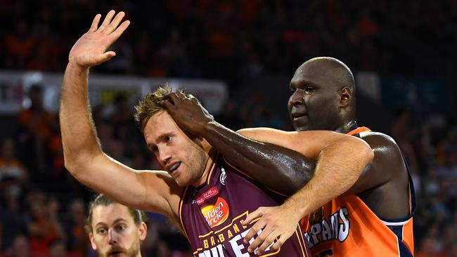 GETTING PHYSICAL: Mitch Young gets a massage from Taipans star Nate Jawai. PICTURE: Ian Hitchcock/Getty Images