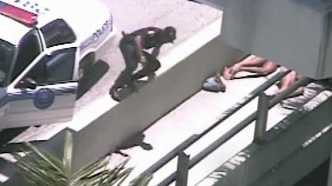 A naked man was shot dead by police after eating another man's face off in Miami. Picture: Courtesy of Miami Herald CCTV