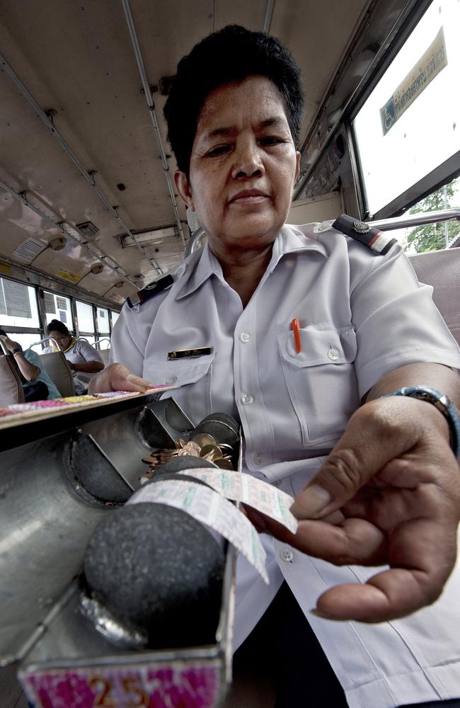 Adult nappies are causing health problems ... Bus fare collector Watcharee Viriya collecting fares from passengers as the bus travels on a street in Bangkok.