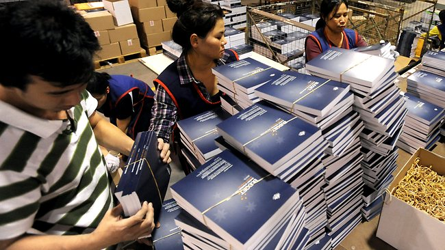 Staff box the budget papers at the printers in Canberra. Picture: Alan Porritt / Pool photo