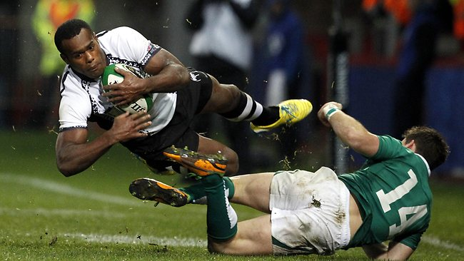 Fiji's Apisai Ratuniyarawa, is tackled by Ireland's Craig Gilroy at Thomond Park. Ireland won the Test 53-0. Picture: Peter Morrison