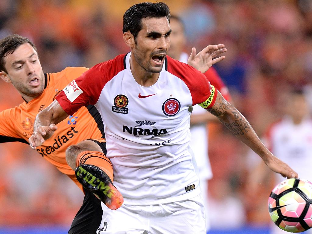 WSW captain Dimas keeping the ball from Tommy Oar. Image: supplied