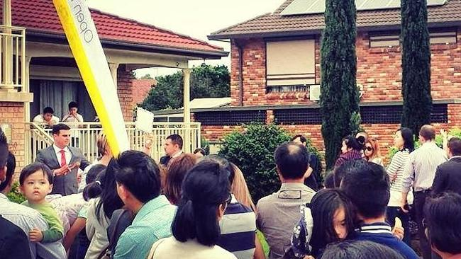 Auctioneer Scott Dalton brings down the hammer on 30 Flemington St, St Johns Park, which sold for $830,000. NSW real estate.