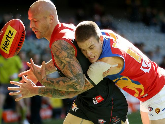 Nathan Jones is tackled by Claye Beams. Picture: Colleen Petch