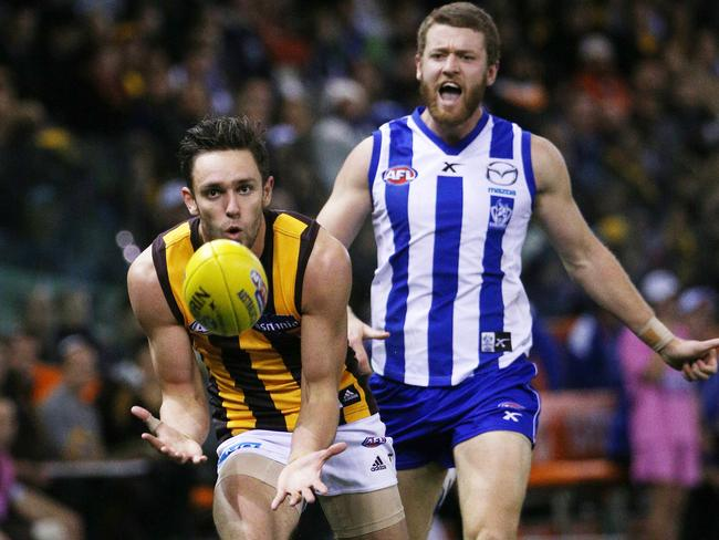 Jack Gunston takes an easy mark in front of Lachie Hansen. Picture: Colleen Petch