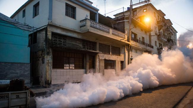 Health authorities with the help of the Cuban army fumigate against the Aedes aegypti mosquito to prevent the spread of zika, chikungunya and dengue in a street of Havana, Cuba two days ago. Picture: Yamil Lage