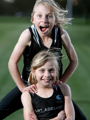 Young twins Chloe (bottom) and Madiosn Schwarz ... setting new athletic records. Picture: Calum Robertson.