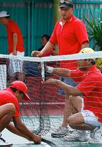 <p>Andrew Chan helps to prepare the net at a tennis competition at Kerobokan jail in Bali. Picture: Lukman S Bintoro</p>