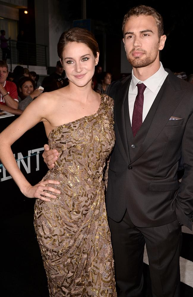 Kissing co-stars? ... Shailene Woodley and Theo James arrive at the premiere of Divergent at the Regency Bruin Theatre in Los Angeles. Picture: Kevin Winter