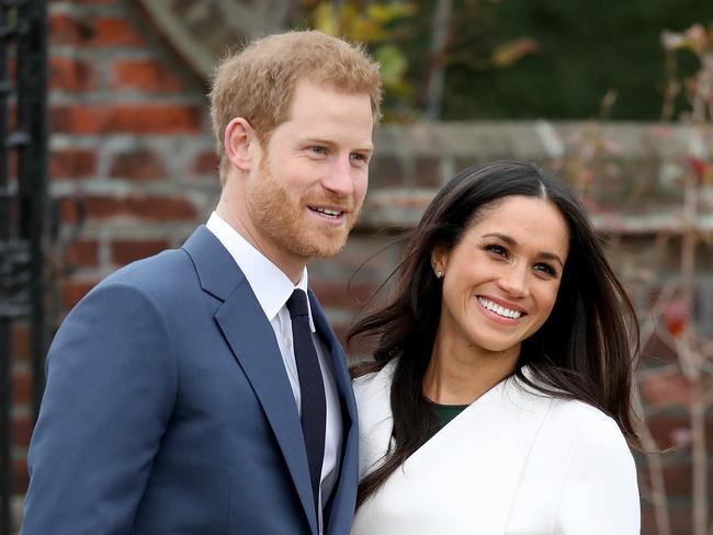 Markle, above with Prince Harry, will never be able to go for a quiet stroll alone again. Picture: Chris Jackson.
