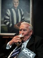Lou enjoys a beer at the launch of Jock: The Story of Jock McHale, Collingwood's Greatest Coach. Picture: Craig Borrow
