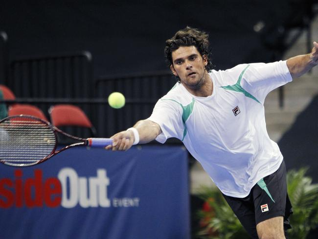 Mark Philippoussis playing against John McEnroe in the Champions Cup.