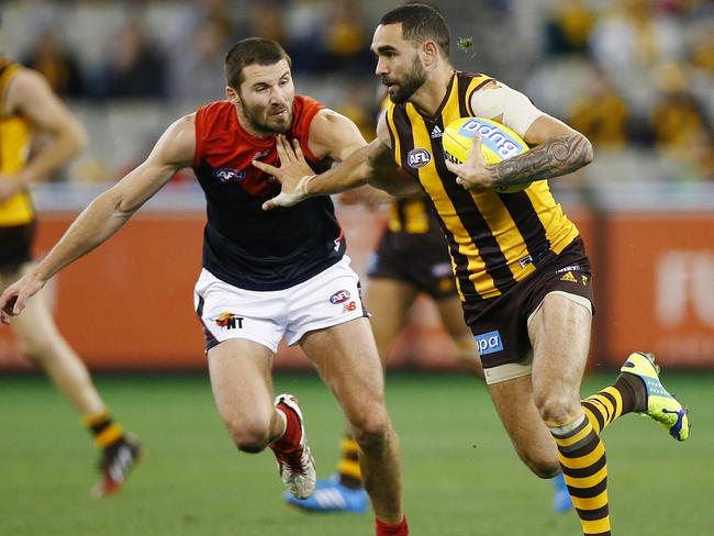 Shaun Burgoyne tries to fend off Colin Garland. Pic: Michael Klein.