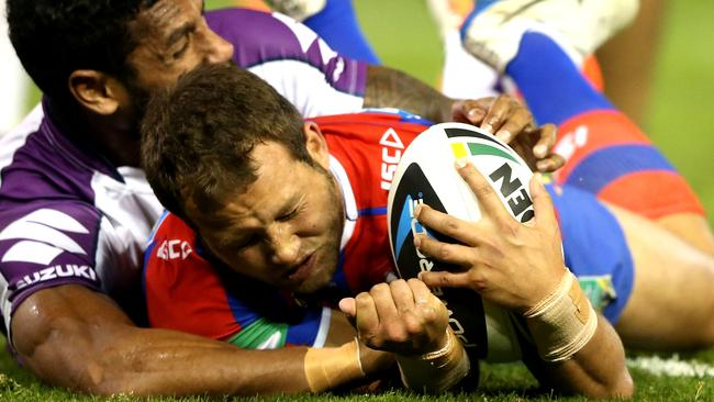 Tyrone Roberts of the Knights scores a try.