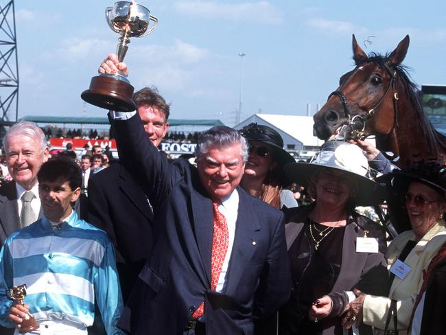 Bart Cummings celebrates winning the 1999 Melbourne Cup with Rogan Josh.