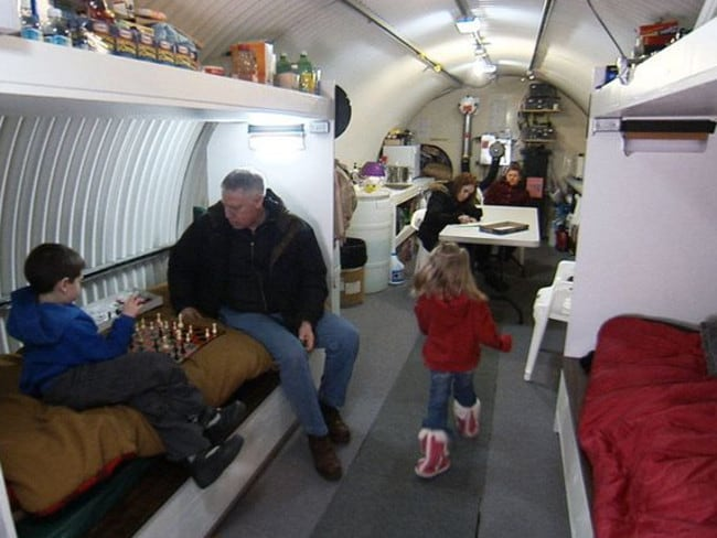 A family in their bunker in a scene from the Doomsday Preppers TV show.
