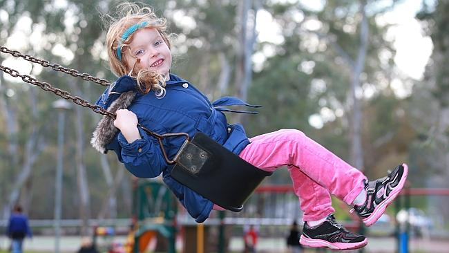 Amelia Vezis, 4, on the swing at Apex Park in Hawthorndene.
