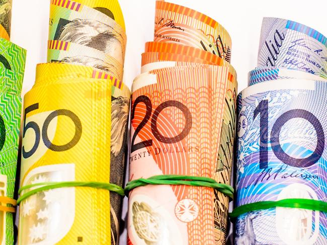 Colourful of Australian Dollars roll with all denomination on white background, generic money