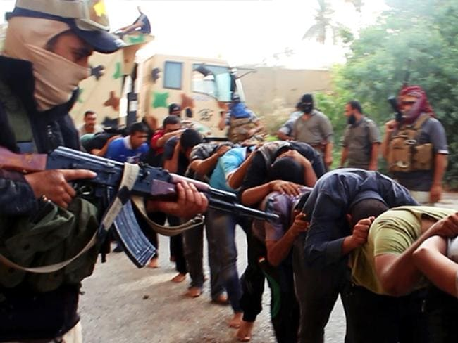 Horrifying ... this image appears to show ISIS militants leading away captured Iraqi soldiers dressed in plain clothes after taking over a base in Tikrit, Iraq.