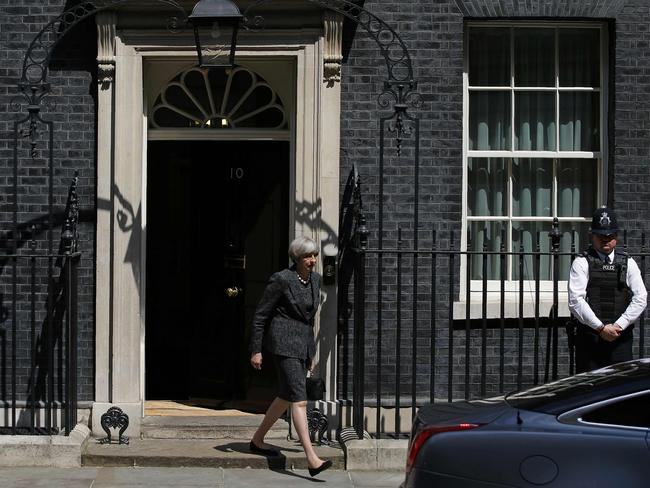 Britain's Prime Minister Theresa May leaves 10 Downing Street in central London. She said she would raise the issue of leaks from a probe into the Manchester terror attack that have infuriated British authorities with their US counterparts at a NATO summit. Picture: AFP / Daniel LEAL-OLIVAS