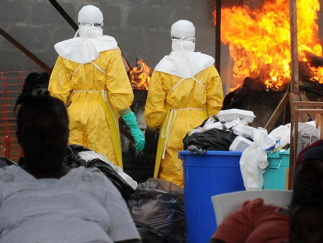 Health workers burn infected items in Monrovia, the hardest hit area.