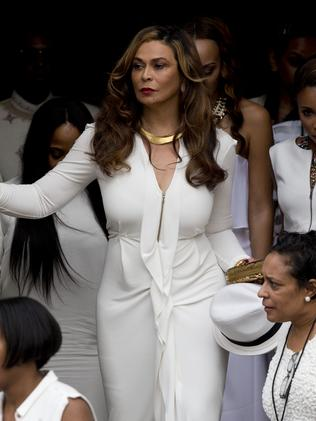 Tina Knowles joins the ivory-clad wedding party. Picture: Splash