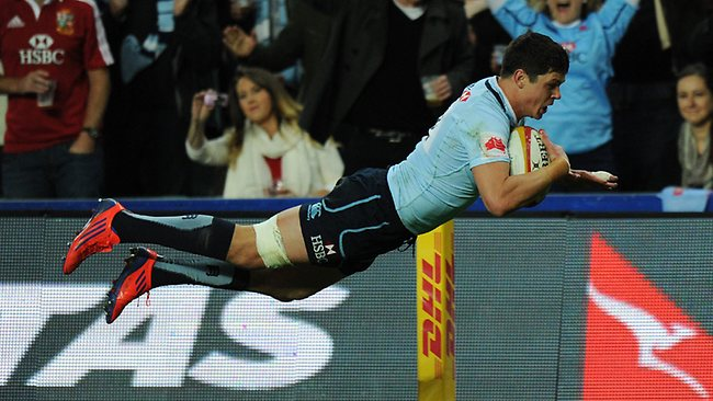 Tom Carter dives over to score the Waratahs' opening try against the British and Irish Lions. Picture: Greg Wood