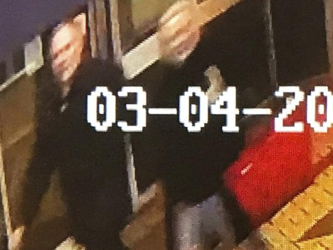 Security camera footage shows a man and woman as they walk through an alleyway connecting a restaurant to a bench where former Russian double agent Sergei Skripal was found. Picture: AP