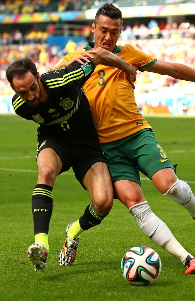 Jason Davidson takes on Juanfran during the World Cup in Brazil.