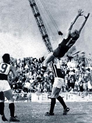 Graham Cornes takes a screamer (well, we assume he caught it ...) during a Glenelg vs Port Adelaide match at Football Park in 1974.