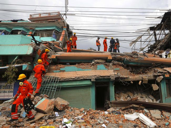 Search mission ... India's National Disaster Response Force personnel look for survivors in a building in Kathmandu, Nepal. Picture: AP Photo/Manish Swarup