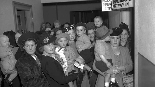 Brisbane mothers line up to have their children immunised against diphtheria in 1941.