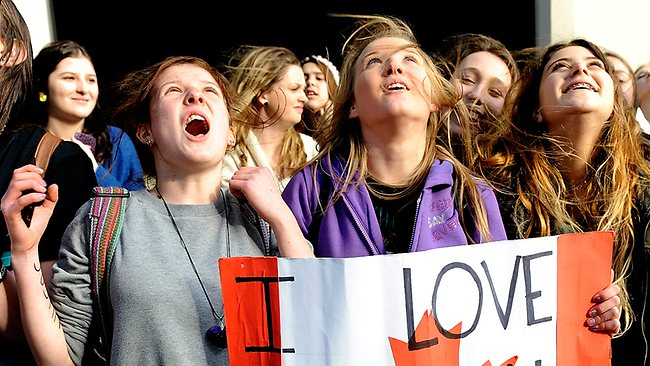 Justin Bieber fans at the Olsen Hotel look up at the upper floors in the hope of seeing him. Picture: Jon Hargest