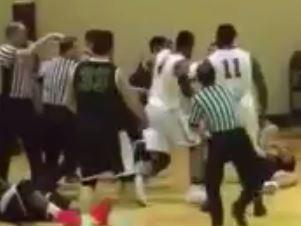 Basketballer viciously head stomps fallen rival
