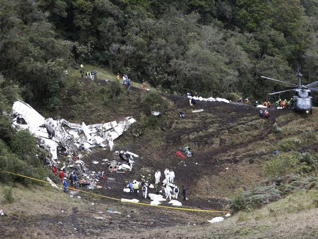 Rescue workers place the bodies of victims of an aeroplane crash into a waiting helicopter, in La Union, near Medellin, Colombia. Picture: AP